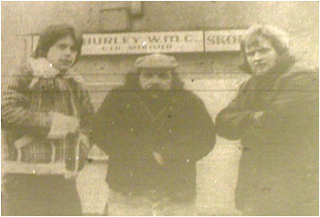 Caption: Out in the cold at Hurley W.M.C…'Ice' guitarist Andy Radek, vocalist Mick Rutherford and drummer Steve Sheldon.
