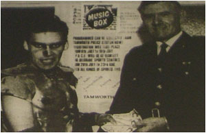 Caption: Blaze Bayley (left of course!) hands over the £50 donation to Superintendent Don Robinson.